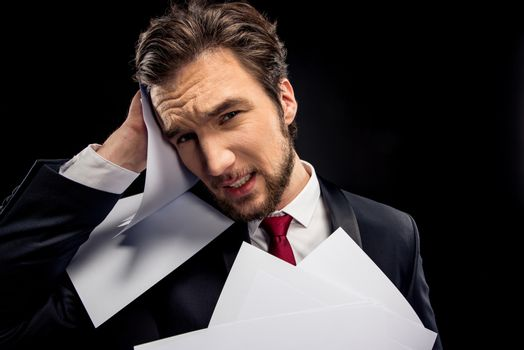Upset businessman holding papers