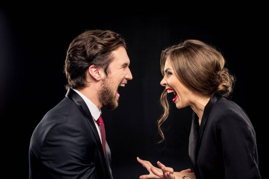 Laughing couple in formal wear
