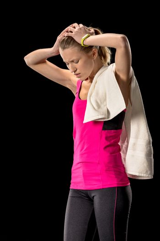 Upset sportswoman with towel