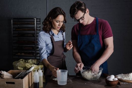 Bakers discussing ingredients