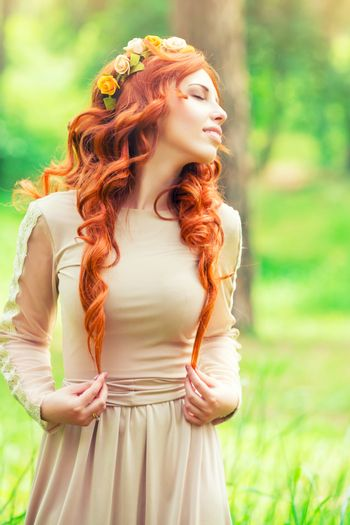 Charming young woman in the forest