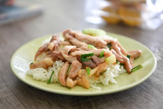 Fried Pork with Garlic Pepper on Rice, Thai food.