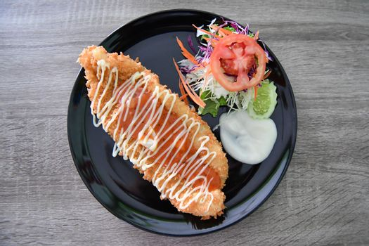 Breaded fried fish Dolly with salad and tartar sauce.