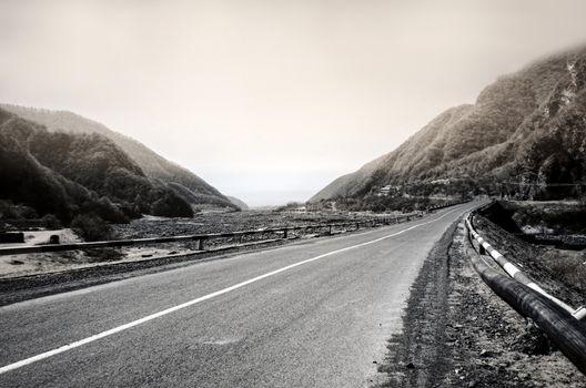 Curved asphalt road in high mountains of ilisu, Gakh, Azerbaijan. Greyscale landscape