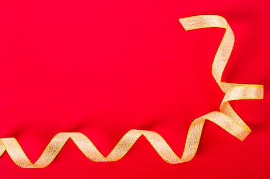 Golden ribbon on red background.