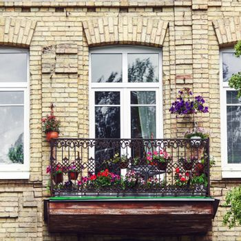 Classic style balcony with flowers at summertime