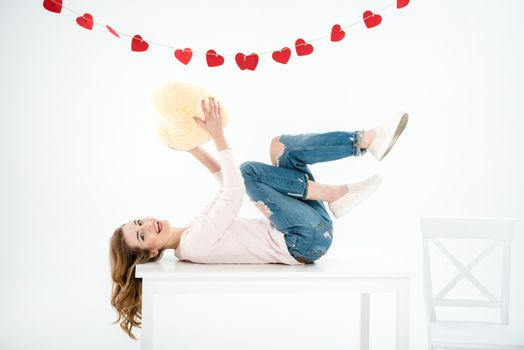 Woman with heart shaped pillow