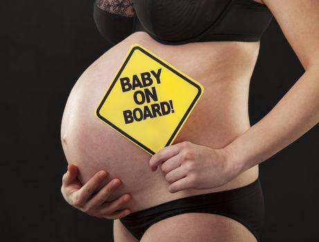 pregnant close abdomen sign