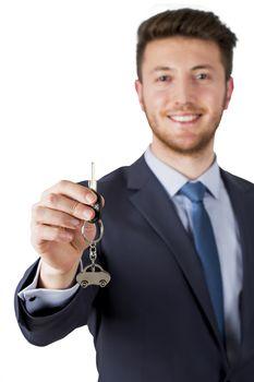 Estate agent giving car keys