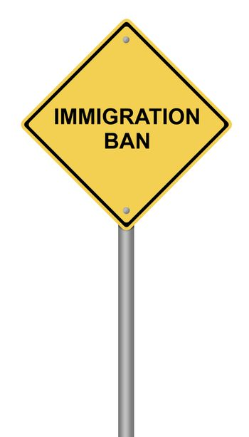 Yellow warning sign with the text Immigration Ban.