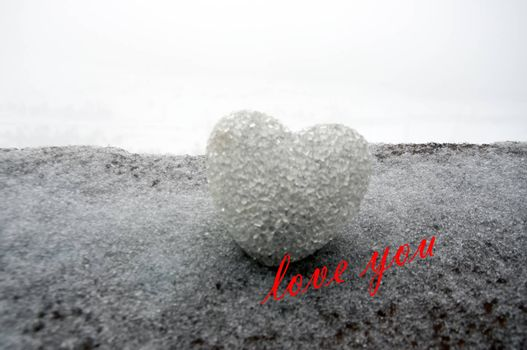 abstract glass heart on snow at night. Card for a Valentine's day. Forgive me, miss you love you words red or greyscale colored. selective