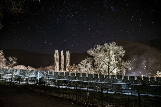 Beautiful night landscape of old ruined wall with stars at sky, long exposure, Sheki, Azerbaijan, Big Caucasus