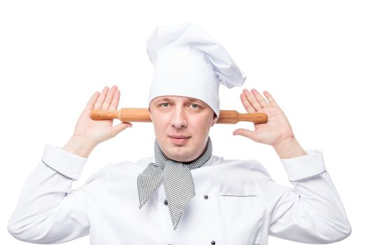 humorous chef with a wooden rolling pin on a white background