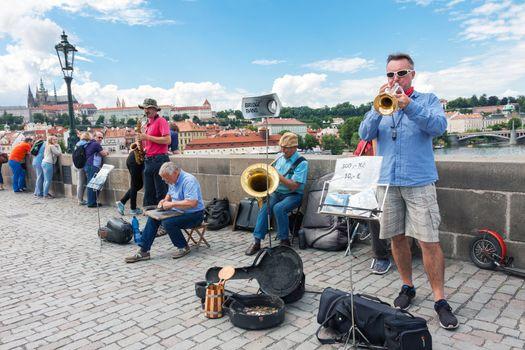 PRAGUE, CZECH REPUBLIC - JUNE 27, 2016: Street music band performing on famous Charles bridge in Prague, Czech Republic