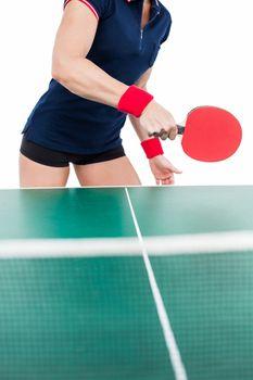Ping pong player hitting the ball