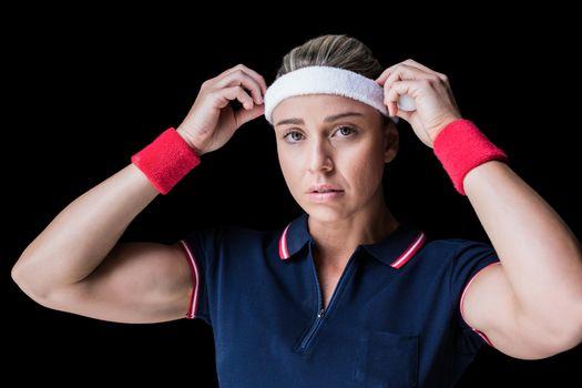 Female athlete adjusting her headband