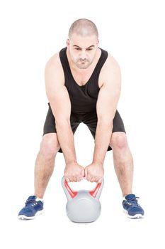 Bodybuilder lifting heavy kettlebell