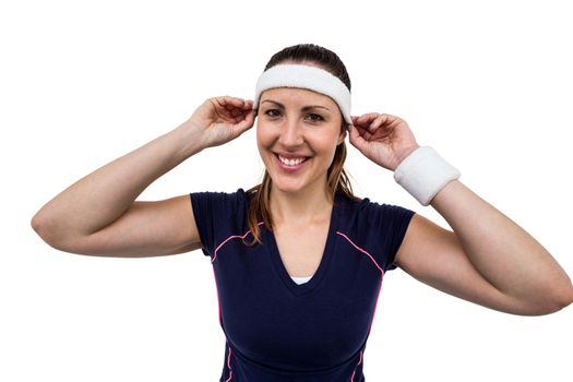 Female athlete wearing headband and wristband