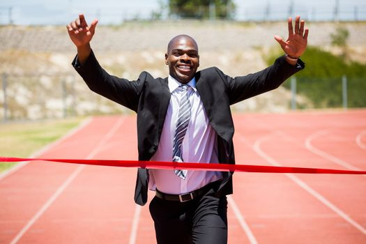 Successful businessman crossing the finishing line