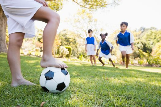 Children wearing soccer uniform playing a match