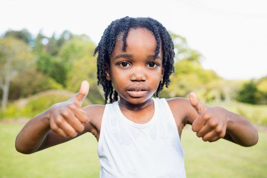 Kid posing at camera during a sunny day