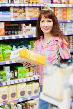 Beautiful woman posing with item