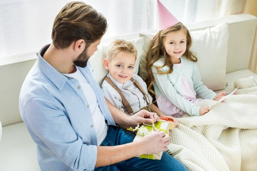 Father and children with presents