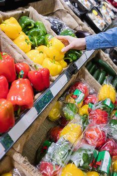 Hand picking a pepper