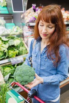 Customer picking a broccoli