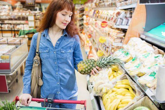 Customer picking a pineapple