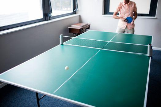 Senior playing ping pong