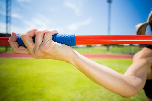 Female athlete about to throw a javelin