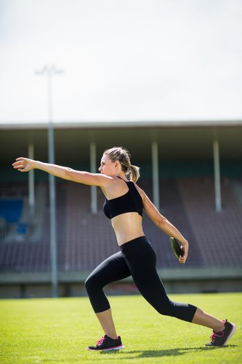 Female athlete about to throw a discus