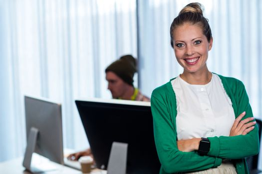 Businesswoman posing front of her coworker