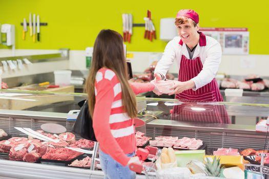 A butcher serving his customer