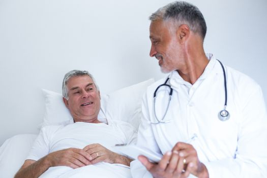 Male doctor and senior man interacting with each other