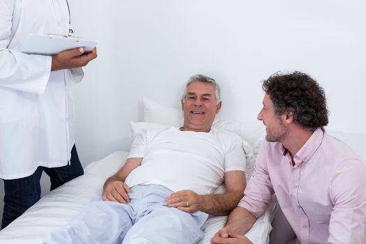 Man sitting next to patient