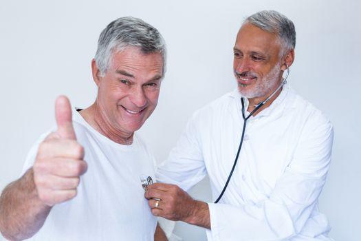 Doctor examining a senior man