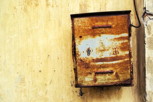 Old rusty weathered mailbox