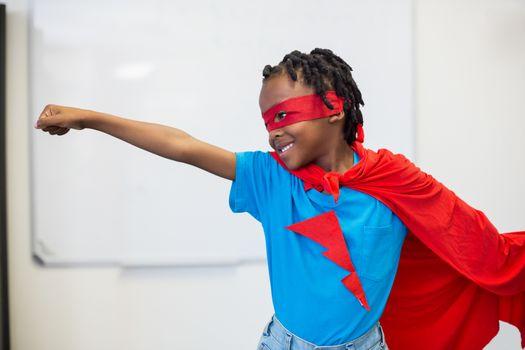 Boy pretending to be a superhero