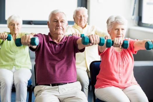 Seniors using weights