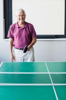 Senior playing ping-pong