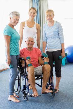 Seniors holding weights