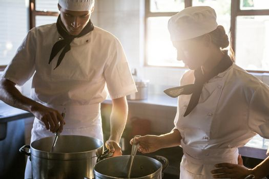 Chefs preparing food at stove