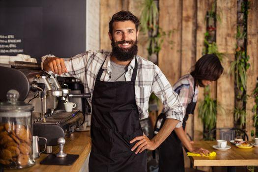 Waiter using a coffee machine