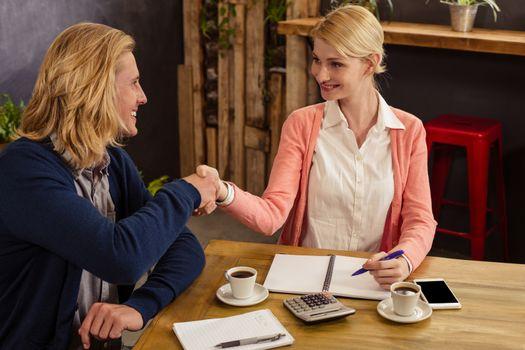 Partners handshaking together