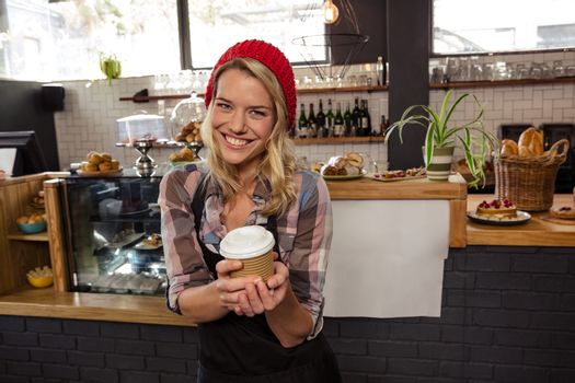 Waitress holding a disposable cup