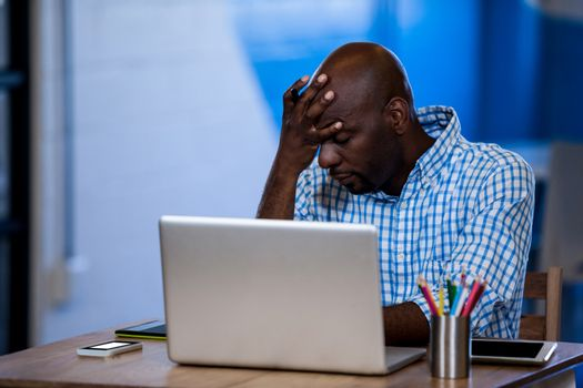 Annoyed businessman front of his laptop