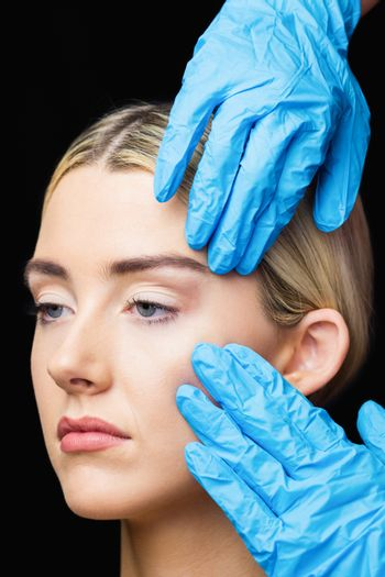 Woman has an examination of her skin before botox injection