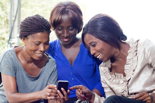 These young women surprised and pleased to discover new mobile application.